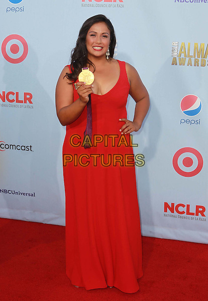 Olympian Brenda Villa.2012 NCLR ALMA Awards - arrivals, held at The Pasadena Civic Auditorium, Pasadena, California USA..16th September 2012.full length red dress medal winner hand on hip  .CAP/ADM/KB.©Kevan Brooks/AdMedia/Capital Pictures.