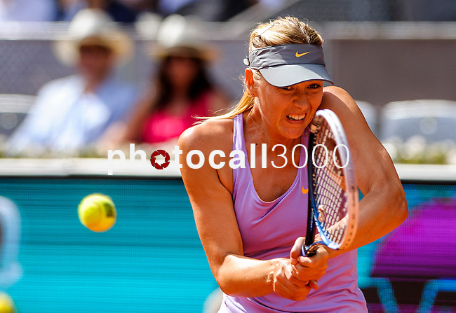"""Russian tennis player Maria Sharapova returns a ball during their women's singles final tennis match of the Madrid Masters at the """"Caja Magica"""" sports complex in Madrid on May 11, 2014.<br /> <br /> Photocall3000/Daniel Calleja"""