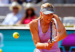 "Russian tennis player Maria Sharapova returns a ball during their women's singles final tennis match of the Madrid Masters at the ""Caja Magica"" sports complex in Madrid on May 11, 2014.<br /> <br /> Photocall3000/Daniel Calleja"