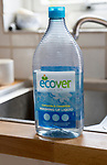 Plastic container bottle of Ecover environmentally friendly washing-up liquid on kitchen sink, England, UK