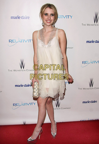 EMMA ROBERTS.Relativity Weinstein Company 68th Annual Golden Globe Awards After Party Presented by Marie Claire held at the Beverly Hilton, Beverly Hills, California, USA..January 16th, 2011.full length white dress sheer clutch bag silver shoes .CAP/ADM/TB.©Tommaso Boddi/AdMedia/Capital Pictures.