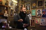 """Samer al-Zuhdi, a 27 year-old Palestinian man, works in a street cafe, at the beach of Gaza city, on April 21, 2019. Al-Zuhdi works at his own street cafe named Mövenpick """" a world-class Hotels & Resorts management company headquartered in Baar, Switzerland"""". Photo by Mahmoud Ajjour"""