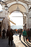 ITALY, Venice. Tourists on the Rialto Bridge enjoying the view of the Grand Canal.