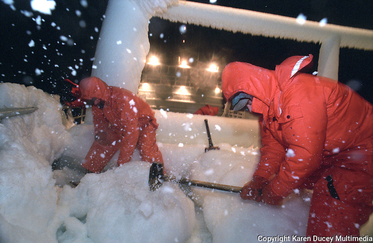 "Crewmen beat ice off the bow of the fishing vessel ""Kiska Sea"" during an opilio crab fishing season in the the Bering Sea in January and February of 1995.  Ice is formed when waves crash over the bow and freeze immediately to anything they touch.  Several feet of ice had covered the boat in just a matter of hours during this storm.  The Bering Sea is known for having the worst storms in the world.  Nights are long and cold in the arctic in the winter.  Crab fishing in the Bering Sea is considered to be one of the most dangerous jobs in the world.  This fishery is managed by the Alaska Department of Fish and Game and is a sustainable fishery.  The Discovery Channel produced a TV series called ""The Deadliest Catch"" which popularized this fishery."