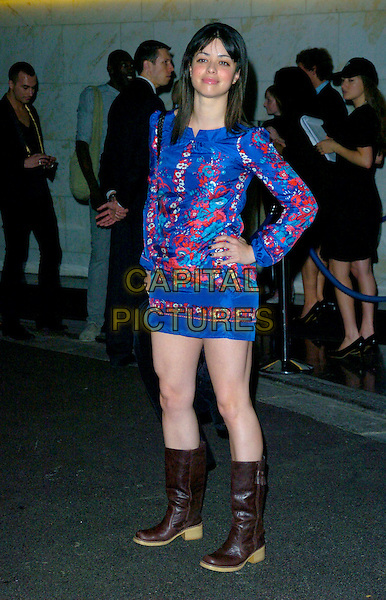 TINA BARRETT.The Premier Model Management & Fashion TV Party, Hotel Intercontinental, London, England..June 14th, 2007.full length blue dress floral print red brown boots hand on hip .CAP/CAN.©Can Nguyen/Capital Pictures
