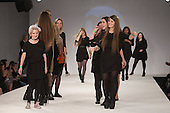 Students of  Istituto Marangoni on the runway. Graduate Fashion Week 2014, Runway Show at the Old Truman Brewery in London, United Kingdom. Photo credit: Bettina Strenske