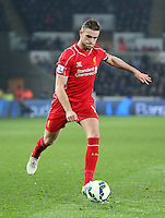 SWANSEA, WALES - MARCH 16: Jordan Henderson of Liverpool in action during the Premier League match between Swansea City and Liverpool at the Liberty Stadium on March 16, 2015 in Swansea, Wales