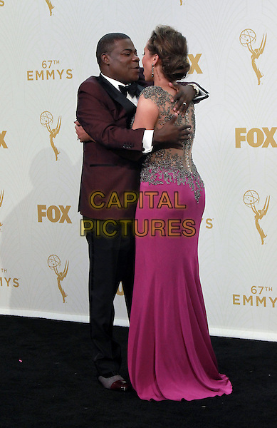 20 September 2015 - Los Angeles, California -  Tracy Morgan and wife Megan Wollover. 67th Annual Primetime Emmy Awards Press Room held at Microsoft Theater. <br /> CAP/ADM/THB<br /> &copy;THB/ADM/Capital Pictures