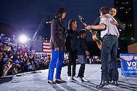 02 Nov 2008, Cleveland, Ohio, USA --- Democratic presidential candidate Senator Barack Obama and his wife Michelle greet singer Bruce Springsteen, after he performed at Obama's campaign rally in Cleveland, Ohio. --- Image by © Brooks Kraft/Corbis