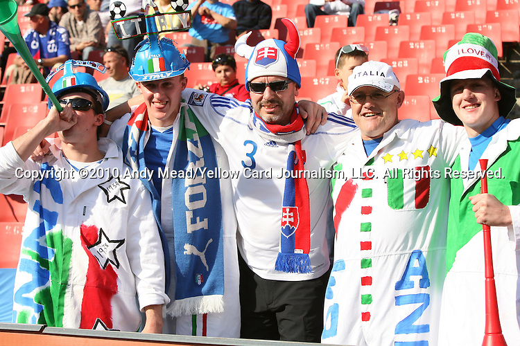 24 JUN 2010: Italy fans pose with a Slovakia fan (center), pregame. The Slovakia National Team played the Italy National Team at Ellis Park Stadium in Johannesburg, South Africa in a 2010 FIFA World Cup Group F match.