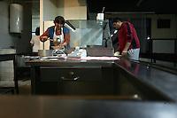 "SERBIA, Belgrade, Jan. 18, 2007..Man takes his diner in a shared kitchen in a refugee camp ""Krnjaca"" near Belgrade..© Djordje Jovanovic /EST&OST"