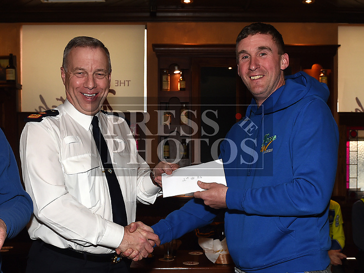 Chairperson Andrew Watters presents Drogheda Wheelers rider Andy O'Brien with his 2nd place prize for unplaced A4 in the 10th Anniversary edition of the Peter Bidwell Memorial cycle race at Donore. Photo:Colin Bell/pressphotos.ie