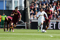 Pictured: Jonathan de Guzman of Swansea (with ball) is chased by L-R Vincent Kompany, Gareth Barry and Yaya Toure of Manchester City. Saturday 04 May 2013<br /> Re: Barclay's Premier League, Swansea City FC v Manchester City at the Liberty Stadium, south Wales.