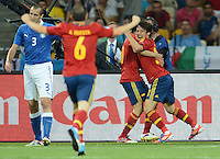 01.07.2012 Kiev, Ukraine.  Spain's David Silva (R) celebrates with CescFabregas(hidden) and Andres Iniesta after scoring the goal for 1-0 during the UEFA EURO 2012 final soccer match Spain vs. Italy at the Olympic Stadium in Kiev, Ukraine, 01 July 2012.