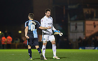 Goalkeeper Matt Ingram of Wycombe Wanderers & Matt Bloomfield of Wycombe Wanderers during the Sky Bet League 2 match between Wycombe Wanderers and Oxford United at Adams Park, High Wycombe, England on 19 December 2015. Photo by Andy Rowland.