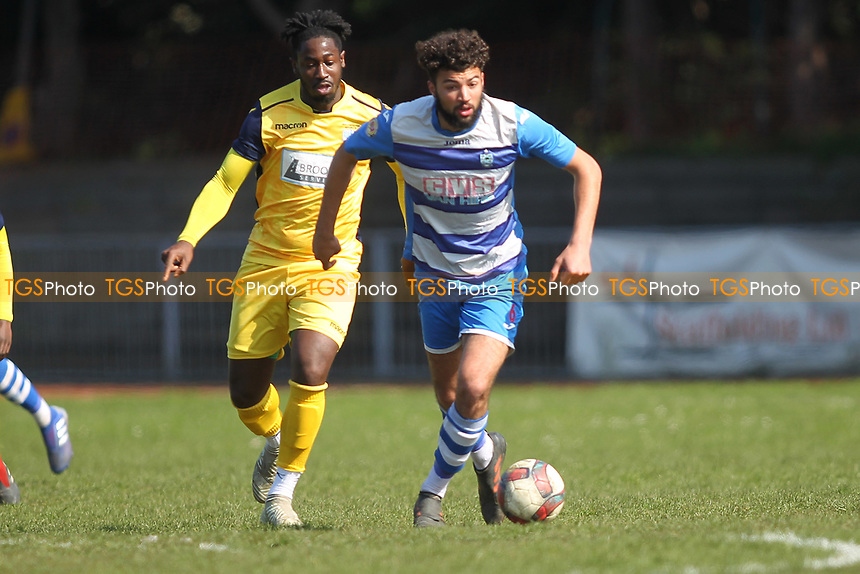 Billy Golledge of Ilford Dan Okah of IHullbridge and during Ilford vs Hullbridge Sports, Essex Senior League Football at Cricklefields Stadium on 13th April 2019