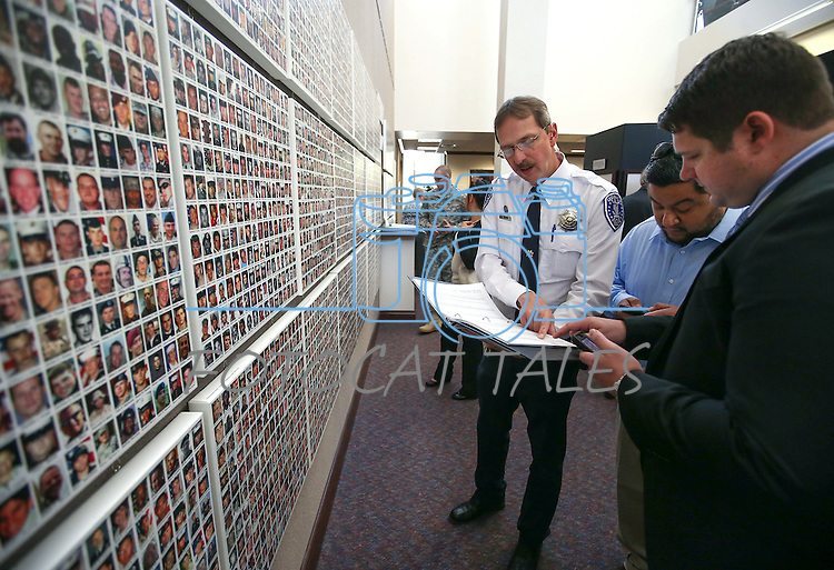 Visitors search for names on the Wall of the Dead at the Always Lost: A Meditation on War exhibit at the Legislative Building in Carson City, Nev., on Monday, April 6, 2015. <br />