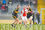 Conor O'Sullivan Rathmore goes past Daithi Casey and Luke Quinn Crokes during the O'Donoghue Cup final in Fitzgerald Stadium on Sunday