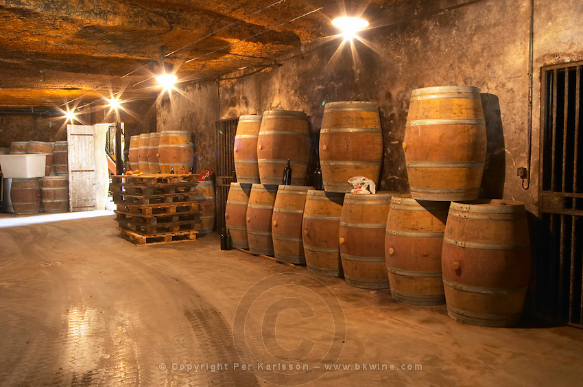 The underground winery and cellar in an old stone quarry, empty oak barrels waiting to be filled with wine Chateau Belair (Bel Air) 1er premier Grand Cru Classe Saint Emilion Bordeaux Gironde Aquitaine France