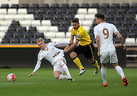 Pictured L-R: Adam King of Swansea against Jordan Lyden of Aston Villa Monday 25 April 2016<br /> Re: Play Off semi final, Swansea City AFC U21 v Aston Villa FC U21 at the Liberty Stadium, Swansea, UK