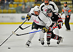 28 January 2012: University of Vermont Catamount defenseman Drew MacKenzie, a Senior from New Canaan, CT, works against Northeastern University Huskies' forward Garrett Vermeersch, a Junior from Macomb, MI, at Gutterson Fieldhouse in Burlington, Vermont. The Catamounts, dressed in their Breast Cancer Awareness jerseys, fell to the Huskies 4-2 in the second game of their 2-game Hockey East weekend series. Mandatory Credit: Ed Wolfstein Photo