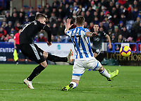 Burnley's Charlie Taylor shoots at goal under pressure from Huddersfield Town's Eric Durm <br /> <br /> Photographer Andrew Kearns/CameraSport<br /> <br /> The Premier League - Huddersfield Town v Burnley - Wednesday 2nd January 2019 - John Smith's Stadium - Huddersfield<br /> <br /> World Copyright © 2019 CameraSport. All rights reserved. 43 Linden Ave. Countesthorpe. Leicester. England. LE8 5PG - Tel: +44 (0) 116 277 4147 - admin@camerasport.com - www.camerasport.com