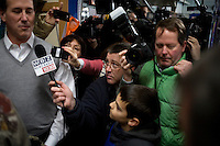 Members of the media follow Rick Santorum as he walks through Pelletier's Sports Shop in Jaffrey, New Hampshire, on Jan. 6, 2012.  Santorum is seeking the 2012 GOP Republican presidential nomination.