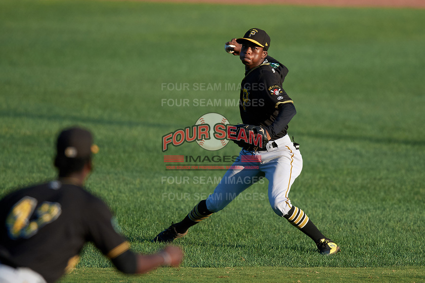 Bristol Pirates shortstop Victor Ngoepe (5) throws to third base during a game against the Bluefield Blue Jays on July 26, 2018 at Bowen Field in Bluefield, Virginia.  Bristol defeated Bluefield 7-6.  (Mike Janes/Four Seam Images)