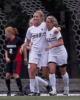 Boston College forward Stephanie Wirth (22) celebrates her goal with teammates. Boston College defeated North Carolina State,1-0, on Newton Campus Field, on October 23, 2011.