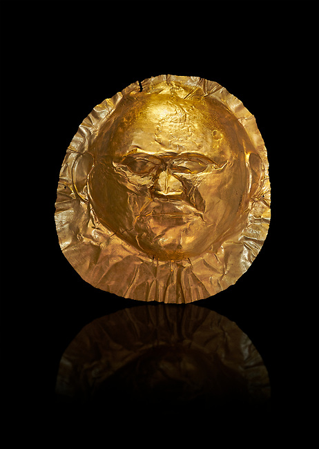 Mycenaean gold death mask, Grave Cicle A, Mycenae, Greece. National Archaeological Museum of Athens.  Black Background<br /> <br /> This death mask is typical of the other Mycenaean gold death masks fround in Grave V except in this mask the eyes are open. made from a sigle sheet of gold the shape of the face would have been hammered ot against wood. two holes either side of the gold mask allowed it to be held over the dead mans face. As weapons were found in the graves of Grave Circle A at Mycenae, those buried here wer warriors and maybe kings as the grave goods buried with them were of great value. 16th century BC