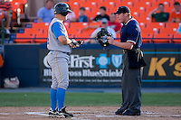Home plate umpire Andy Dudones tells Eric Campbell (24) of the Myrtle Beach Pelicans that it was strike 3 at Harry Grove Stadium in Frederick, MD, Monday July 14, 2008. (Photo by Brian Westerholt / Four Seam Images)
