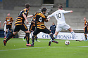 Raith Rovers' Joe Cardle's (hidden left) cross / shot goes under the legs of Calum Elliot for their first goal.