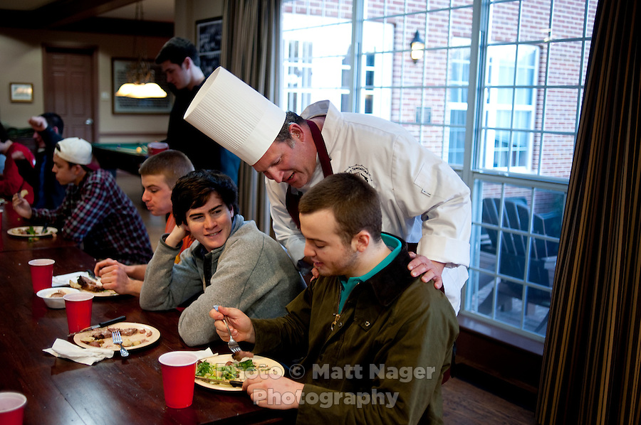 Professional Chef Ken Cobb (cq) jokes with James Moreton (cq) and Austin Smith (cq) during dinner at the Sigma Alpha Epsilon fraternity house on the Southern Methodist University campus in Dallas, Texas, Friday, january 20, 2011. Some high-end chefs have found professional salvation from an unlikely location: Fraternity Row. Cobb employs a pair of interns from the Dallas Culinary Institute, where he once served as lead instructor, to help him cook three meals every weekday for another pair of frat houses on SMU's campus...Matt Nager for The Wall Street Journal