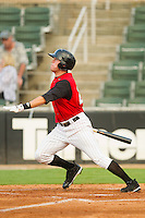 Nicholas Ciolli #20 of the Kannapolis Intimidators follows through on his swing against the Greensboro Grasshoppers at Fieldcrest Cannon Stadium August 2, 2010, in Kannapolis, North Carolina.  Photo by Brian Westerholt / Four Seam Images