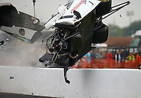 Apr 29, 2016; Baytown, TX, USA; NHRA  pro mod driver Sidnei Frigo goes airborne as he crashes during qualifying for the Spring Nationals at Royal Purple Raceway. Frigo was alert and transported via helicopter to a local hospital. Mandatory Credit: Mark J. Rebilas-USA TODAY Sports