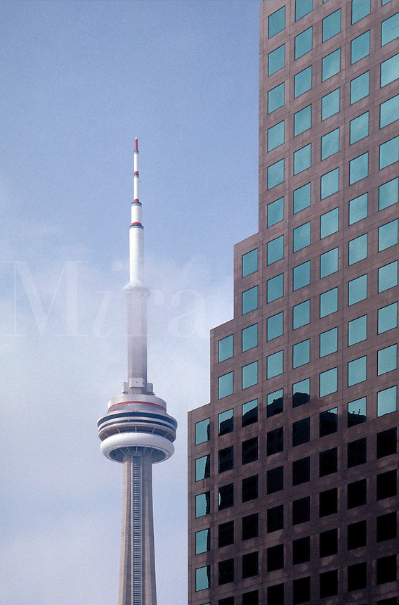 Toronto's CN Tower with a building detail in the foreground. Toronto, Canada Ontario.