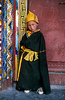 Young pilgrim in sneakers, Litang, Kham, Tibet 2006 .