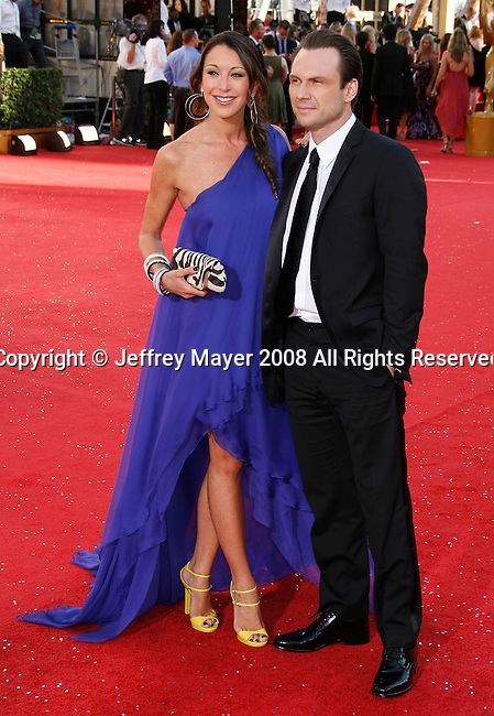 LOS ANGELES, CA. - September 21: Actor Christian Slater (R) and Tamara Mellon arrive at the 60th Primetime Emmy Awards at the Nokia Theater on September 21, 2008 in Los Angeles, California.