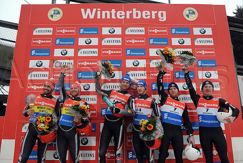 20.02.2016. Winterberg, Germany.  (L-R) Runner-ups Tobias Wendl and Tobias Arltof Germany, winners Toni Eggert and Sascha Benecken of Germany, and Oskars Gudramovics and Peteris Kalnins of Latvia celebrate during the victory ceremony following the men's two-seater event at the Luge World Cup in Winterberg, Germany, 20 February 2016.