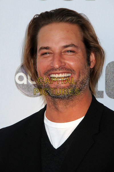 """JOSH HOLLOWAY.""""Lost"""" Live: The Final Celebration held at UCLA's Royce Hall, Westwood, California, USA..May 13th, 2010.headshot portrait black white stubble facial hair beard smiling .CAP/ADM/BP.©Byron Purvis/AdMedia/Capital Pictures."""