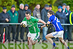 Keith Sheehan Laune Rangers tries to stop Ian Twiss Milltown Castlemaine getting the equalizer deep into injury time in the Mid Kerry final in Beaufort on Saturday