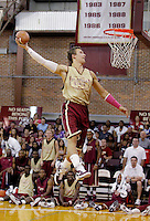 TALLAHASSEE, FLA. 10/15/10-FSUMBB 101510 CH-Florida State's Deividas Dulkys stays with the spirit of football season as he slams a pigskin for the dunk competition during Jam with Ham basketball season kickoff Friday at Tully Gym in Tallahassee. Dulkys won the contest...COLIN HACKLEY PHOTO