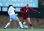 UNC's Yael Averbuch (32) strips the ball away from Florida State's Viola Odebrecht (7) on Friday, November 25th, 2005 at Fetzer Field in Chapel Hill, North Carolina. The Florida State Seminoles defeated the University of North Carolina Tarheels 5-4 on penalty kicks after the teams tied 1-1 after overtime during their NCAA Women's Soccer Tournament quarterfinal game.
