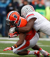 Illinois Fighting Illini running back Josh Ferguson (6) is tackled by Ohio State Buckeyes defensive lineman Noah Spence (8) during Saturday's NCAA Division I football game at Memorial Stadium in Champaign, Il., on November 16, 2013. Ohio State won the game 60-35. (Barbara J. Perenic/The Columbus Dispatch)