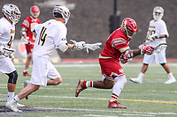 Towson, MD - March 25, 2017: Denver Pioneers Trevor Baptiste (9) wiins the faceoff during game between Towson and Denver at  Minnegan Field at Johnny Unitas Stadium  in Towson, MD. March 25, 2017.  (Photo by Elliott Brown/Media Images International)