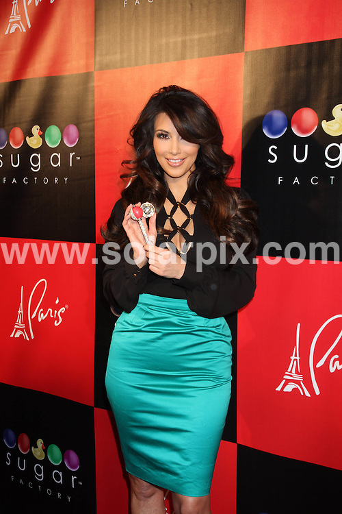 **ALL ROUND PICTURES FROM SOLARPIX.COM**                                             **SYNDICATION RIGHTS FOR UK, AUSTRALIA, DENMARK, PORTUGAL, S. AFRICA, SPAIN & DUBAI (U.A.E) & ASIA (EXCLUDING JAPAN) ONLY**                                                                                  Caption: Sugar Factory American Brasserie Grand Opening at Paris Las Vegas NV, USA                                                                              .This pic: Kim Kardashian                                                                                             JOB REF: 12919       PHZ       DATE:  04.03.2011                                                          **MUST CREDIT SOLARPIX.COM OR DOUBLE FEE WILL BE CHARGED**                                                                      **MUST AGREE FEE BEFORE ONLINE USAGE**                               **CALL US ON: +34 952 811 768 or LOW RATE FROM UK 0844 617 7637**