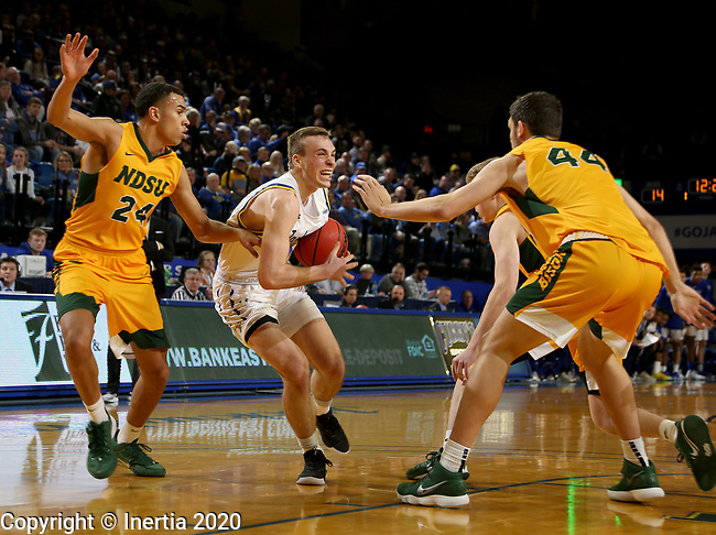 BROOKINGS, SD - JANUARY 22: Noah Freidel #11 of the South Dakota State Jackrabbits drives toothed basket against Tyson Ward #24 of the North Dakota State Bison at Frost Arena on January 22, 2020 in Brookings, South Dakota. (Photo by Dave Eggen/Inertia)