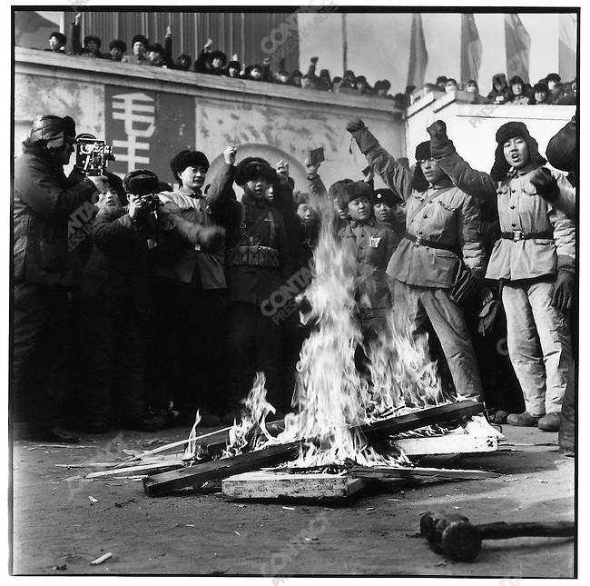 A large crowd gathers to cheer as rebel factions and PLA soldiers smash and burn the placard of the Harbin municipal government in Red Guard Square. Harbin, 16 February 1967