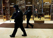 New York City Police officers are seen walking through the lobby of Trump Tower in New York, New York, USA, 08 January 2017.<br /> Credit: Jason Szenes / Pool via CNP