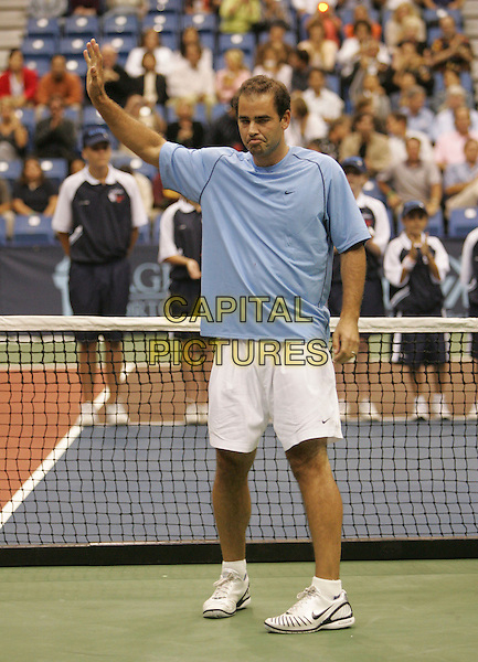 PETE SAMPRAS.The 14th Annual Advanta WTT Smash Hits held at The UC Irvince Bren Center in Irvine, California, USA..September 14th, 2006.Ref: DVS.full length tennis court whie shorts blue tee shirt funny hand waving.www.capitalpictures.com.sales@capitalpictures.com.©Debbie VanStory/Capital Pictures